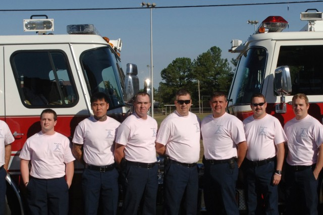 Members of the Fort Bragg Directorate of Emergency Services will don pink T-shirts and gloves throughout the month in observance of National Breast Cancer Month.