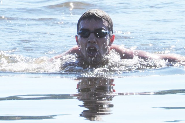 Tyler Scheidt completes the 300-meter swim portion of the Iron Aviator Oct. 15 in Lake Tholocco. He finished first place for individuals in 1:40:30. For more event photos, visit the Army Flier Facebook page.