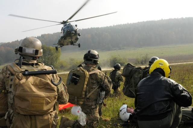 U.S. and Polish Special Operations Forces Soldiers await the landing of a Lithuanian Mi-17 helicopter so they can exfiltrate to safety as part of a casualty evacuation exercise rehearsal held Oct. 14 at the Joint Multinational Readiness Center in Hohenfels, Germany.   The training, coordinated by U.S. Special Operations Command, allows U.S. and partner nation SOF soldiers the opportunity to train together and share tactics, techniques and procedures prior to deploying in support of International Security Assistance Force missions in Afghanistan.