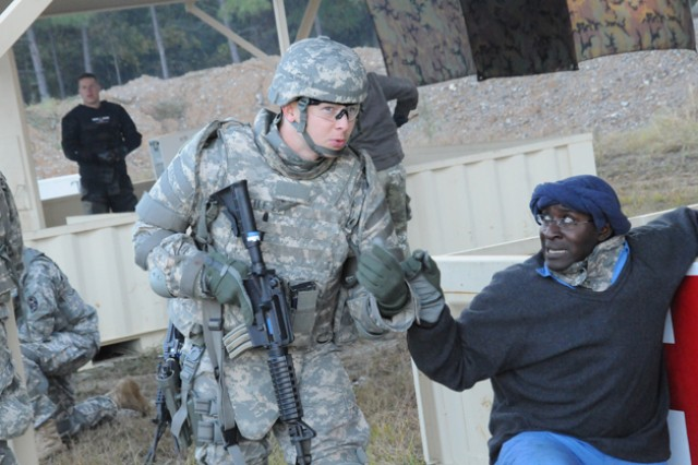 Staff Sgt. Adam Little, National Guard Bureau, listens to a villager during the escalation of force event of the Best Warrior Competition Oct. 22 at Fort Lee.