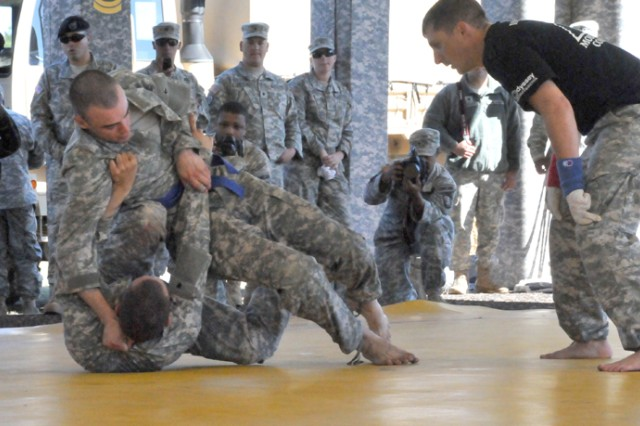 Soldiers competing in the Best Warrior Competition grapple during the combatives tournament.