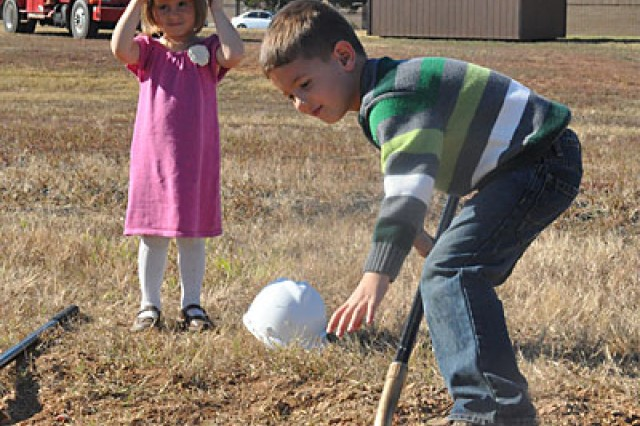 Kate Vineyard, 3, and her brother Jacob, 5, participate in the groundbreaking for the chapel complex, Wednesday. Children of deployed 2nd Battalion, 506th Infantry Regiment, 4th Brigade Combat Team Chap. (Capt.) Jared Vineyard, they were invited to represent military Families who will use the facility when it opens in March 2012. Jared's wife, Amanda, said the children were very excited to take part in the ceremony.