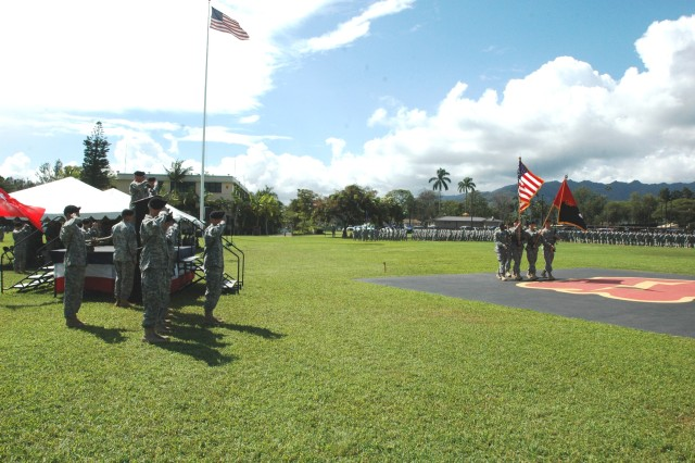 "Major Brian Watkins, executive officer and Commander of Troops, 25th Combat Aviation Brigade, and the official party salute the Colors during the customary pass in review during the ""Wings of Lightning"" Brigade's change of command on Sills Field at Schofield Barracks, Oct. 21. Major General Bernard S. Champoux, commander, 25th Infantry Division, served as the reviewing officer as Col. Mike Lundy relinquished command to Col. Frank Tate.(Photo by: Sgt. 1st Class Tyrone C. Marshall Jr.  25th Combat Aviation Brigade Public Affairs)"