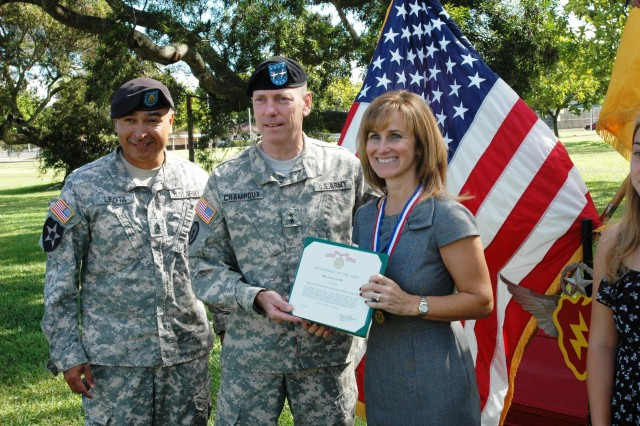 Major General Bernard S. Champoux, commander, 25th Infantry Division (ID), and Command Sgt. Maj. Frank Leota, command sergeant major, 25th ID, present Pamela Lundy, wife of Col. Mike Lundy, outgoing commander, 25th Combat Aviation Brigade (CAB), the Outstanding Civilian Service Award prior to the 25th CAB's change of command on Sills Field at Schofield Barracks, Oct. 21. Lundy relinquished command to Col. Frank Tate during the ceremony.(Photo by: Sgt. 1st Class Tyrone C. Marshall Jr.  25th Combat Aviation Brigade Public Affairs)