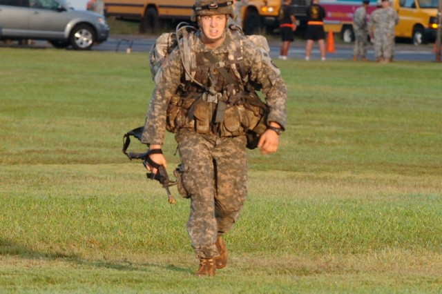 1st Lt. Michael Sudweeks, UH-60 pilot, 3rd Battalion, 25th Aviation Regiment, 25th Combat Aviation Brigade, completes a 12 mile ruck march at Schofield Barracks' Sills Field, Oct. 22. The march is the final event for earning the prestigious Expert Field Medical Badge. Sudweeks earned the EFMB and was presented with the badge at an awards ceremony at Sills Field later that morning.   (Photo by Staff Sgt. Mike Alberts  25th Combat Aviation Brigade Public Affairs)