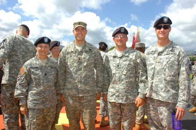 First Lieutenant Michael Sudweeks (pictured second from left), UH-60 pilot, 3rd Battalion, 25th Aviation Regiment, 25th Combat Aviation Brigade (CAB), stands for a photo with Lt. Col. Lori Robinson (far left), commander, 3rd Battalion, 25th Aviation Regiment, 25th CAB, Command Sgt. Maj. Harold Plattenberg (pictured second from right), command sergeant major, 3rd Bn., 25th Avn. Regt., 25th CAB, and Maj. Jacob Dlugosz (far right), commander, C. Co., 3rd Bn., 25th Avn. Regt., 25th CAB, after Sudweeks earned the prestigious Expert Field Medical Badge and was awarded the EFMB during an award ceremony at Schofield Barracks' Sills Field, Oct. 22.   (Photo by Staff Sgt. Mike Alberts  25th Combat Aviation Brigade Public Affairs)