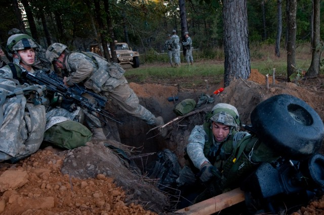 Soldiers leave their defensive fighting positions while preparing for an attack during a Full Spectrum Operation exercise in Ft. Polk, LA, Saturday, Oct. 23, 2010.  The Full Spectrum exercise focuses on facing and defeating a hybrid threat representing both an insurgent force and an organized military force.