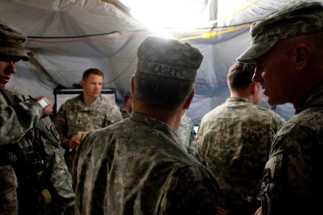 Brig. Gen. Jim Yarbrough, Commanding Gen. of Joint Readiness Training Center, talks with Chief of Staff of the US Army, Gen. George W. Casey Jr., during a Full Spectrum Operation exercise in Ft. Polk, LA, Saturday, Oct. 23, 2010.  The Full Spectrum exercise focuses on facing and defeating a hybrid threat representing both an insurgent force and an organized military force.