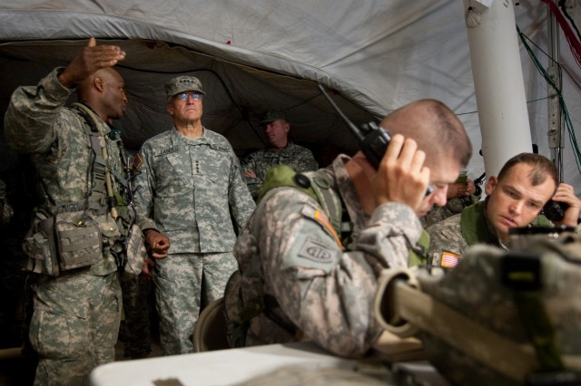 """Col. Carl Alex, commander of the 3rd Brigade Combat Team, 82nd Airborne Division, briefs Chief of Staff of the US Army, Gen. George W. Casey Jr.,  about operations being conducted as part of the Full Spectrum Operation exercise in Ft. Polk, LA, Saturday, Oct. 23, 2010.  The Full Spectrum exercise focuses on facing and defeating a hybrid threat representing both an insurgent force and an organized military force. """""""