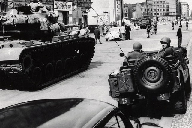 Soldiers from the U.S. Army Berlin Command face off against police from the former East Germany during one of several standoffs at Checkpoint Charlie in 1961. On several occasions that year, a U.S. quick reaction force of tanks and infantry Soldiers stood watch as armed military policemen escorted U.S. personnel across the border into East Berlin.  (U. S. Army Photo)