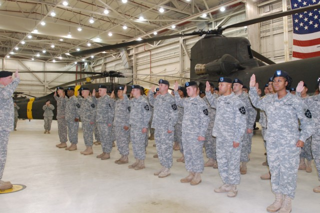Colonel James T. Barker, 2nd Combat Aviation Brigade commander, swears in 43 Soldiers during a mass reenlistment ceremony Oct. 1. - U.S. Army Photo by Cpl. Timothy N. Oberle
