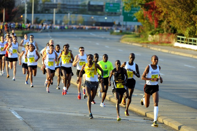 Ethiopian Alene Retna of New York City leads the field through the first mile of the 2010 Army Ten-Miler in 4 minutes, 29 seconds en route to his second consecutive victory at the event with a winning time of 47:10 on Oct. 24 at the Pentagon. PV2 Joseph Chirlee (bib No. 41) of Fort Sam Houston, Texas, Ethiopian Tesfaye Sendeku (45) and U.S. Army World Class Athlete Program Spc. Robert Cheseret (1) of Fort Carson, Colo., are right on Reta's heels. WCAP Maj. Dan Browne (1) is running seventh.