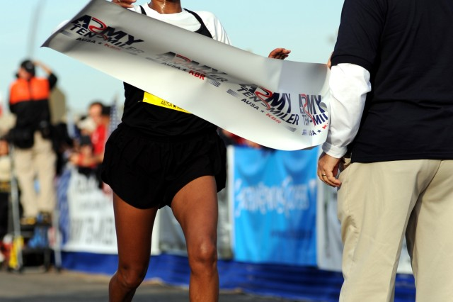 Aziza Abate of Albuquerque, N.M., wins the women's division of the 2010 Army Ten-Miler in 55 minutes, 54 seconds on Oct. 24 at the Pentagon.