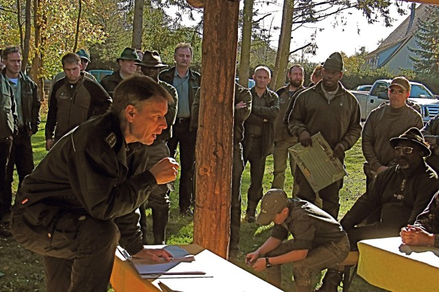 Grafenwoehr Forest Director Ulrich Maushake welcomes hunters and introduces them to their hunting guides.