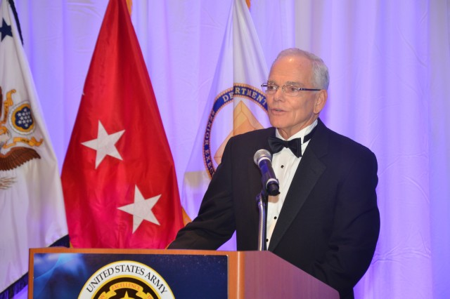 Assistant Secretary of the Army for Acquisition, Logistics and Technology Dr. Malcolm Ross O'Neill congratulates winners Oct. 24 at the Acquisition Corps Annual Awards Dinner in Alexandria, Va.