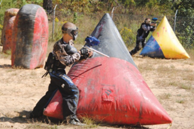 "FORT POLK, La. -- Civilian Matt Mounce (left) and Spc. Eddie Jones participate in a paintball game Oct. 17 at Fort Polk's Range 23A. The players are members of ""Resistance,"" a Fort Polk-based paintball team."