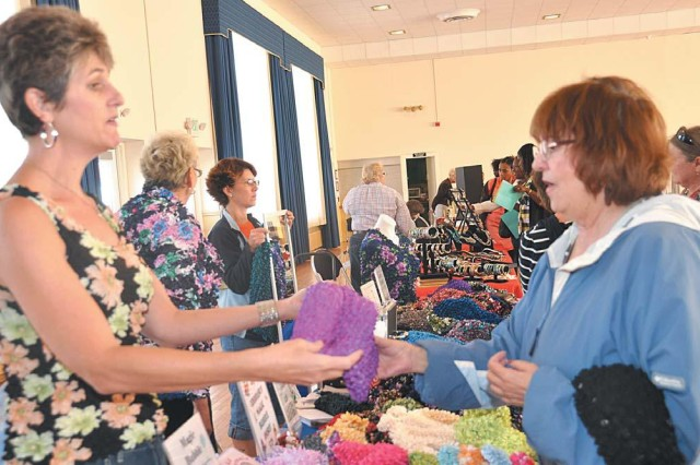 Sharon Jones, left, of Magic Bubble Shirts, shows one of the popular items to Angela Amadeo of the U.S. Army Developmental Test Command during the Fall Bazaar at the Aberdeen Area Recreation Center Oct. 7.