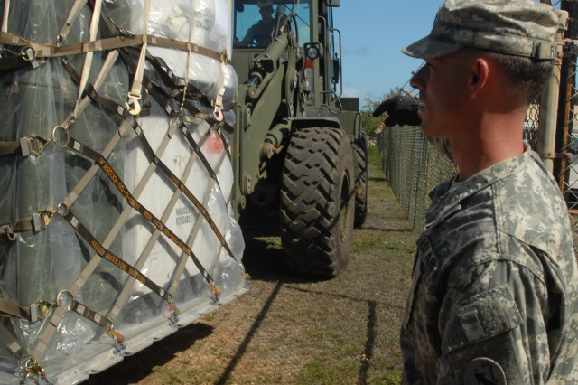 MARINE CORPS BASE HAWAII, (Kaneohe) Hawaii- Sgt. 1st Class Hargis Fulton, U.S. Army, Pacific Contingency Command Post fire support sergeant, guides a forklift operator during the USARPAC CCP Validation Exercise here.