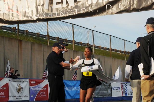 Aziza Abate, 25, of Albuquerque, N.M., took first place in the women's category of the Army Ten-Miler with a time of 55:54.