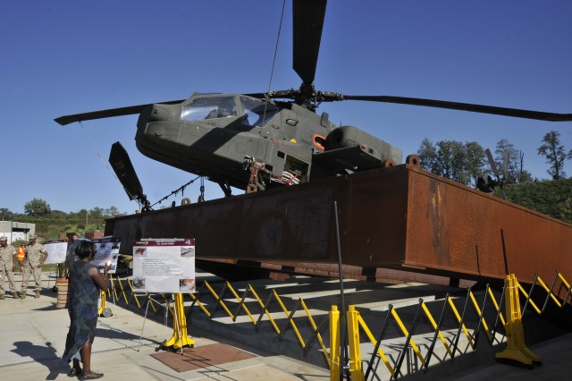 An AH-64D Apache Longbow Block III attack helicopter is mounted to the Army Research Lab's Rotorcraft Survivability and Assessment Facility's tilt-table for later live-fire and other tests and evaluations