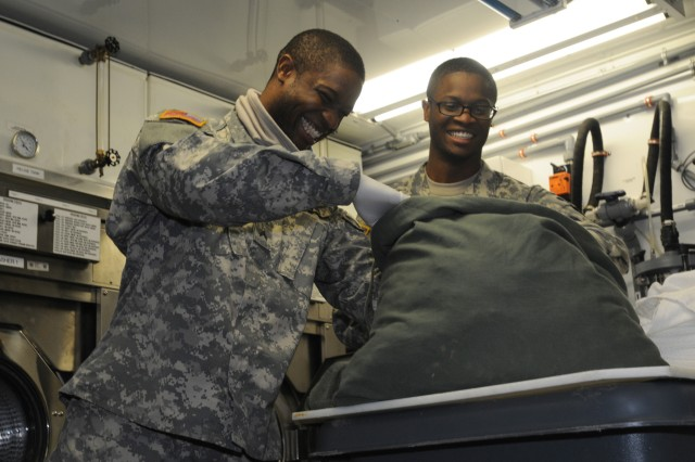 Sgt. Kenneth Wells (right) and Cpl. Keith Wells are one of two sets of twins assigned to the 212th Combat Support Hospital. The 22-year old fraternal twins are currently working as shower, laundry and clothing repair specialists during the US and UK joint medical training exercise in Hohenfels, Germany.