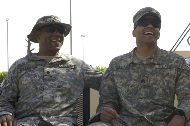20101017-A-3641G-002   Lt. Col. Maurice Williams II, an aviation operations officer with the 1st Armored Division, (left), and his son, Staff Sgt. Maurice T. Williams III, an infantryman with the 3rd Brigade, 101st Airborne Division, spend time together at Camp Arifjan after reuniting for the first time in nine months, Oct. 16.  Staff Sgt. Williams used two of his rest and recuperation leave days to visit with his father before traveling to his hometown of Sacramento, Calif.  (Photo by Sgt. M. Benjamin Gable, 27th Public Affairs Detachment)
