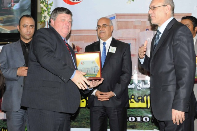 Peter Bodde, assistant chief of mission, U.S. Embassy Baghdad, receives an award at the Basra Children's Hospital's opening ceremony Oct. 21. Bodde spoke about the perseverance and achievements of the project that will provide a foundation for a strong, healthy future for Iraq's children.
