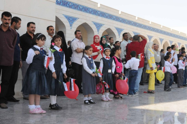 Iraqi children line up to greet more than 300 visitors at the opening of the Basra Children's Hospital Oct. 21. The hospital is a state-of-the art facility in Basra and is the first specialty care unit specializing in pediatric oncology.