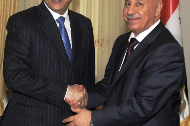 BAGHDAD - The Kurdish Regional Government Ministry of Interior Karim Sinjari greets the Iraq Ministry of Interior Jawad Al Bolani prior to signing a historic memorandum of agreement pledging greater cooperation among the two ministries in Arbil Oct. 20.