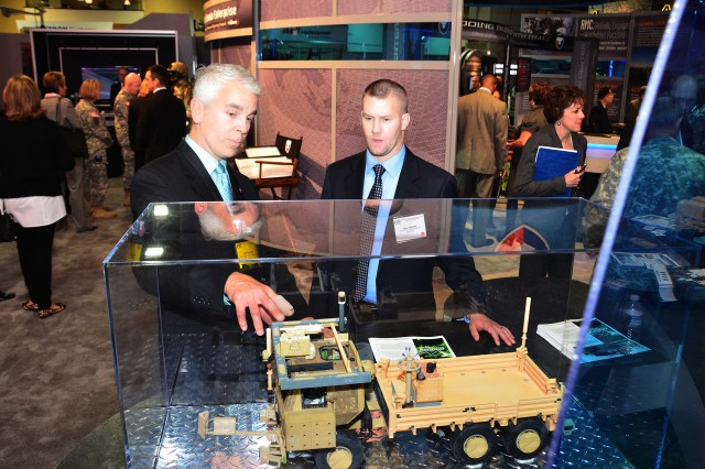 Scott Payton (left) explains his project to a visitor Oct. 26 at the 2010 Association of the United States Army annual meeting at the Washington Convention Center.
