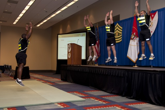 Drill Sergeants, from the United States Army Drill Sergeant School, demonstrate some of the exercises used in basic combat training and highlight some changes included in the Army's new fitness manual, TC 3-22.20, at the 2010 Association of the United States Army convention, in Washington, D.C., on Oct. 26. (U.S. Army photo by Sgt. Angelica G. Golindano)(RELEASED)