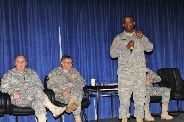 General Jones responds to a question from the audience while Lt. Gen Rick Lynch, Lt. Gen. Jack C. Stultz, Commanding General, U.S. Army Reserve Command and Maj. Gen. Raymond W. Carpenter, Director of the Army National Guard (Acting) look on.