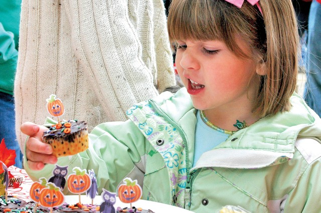 Briana Melton, age 5, chooses a cupcake after winning the cakewalk at the Pumpkin Patch Festival at Paul's Bauernhof Oct. 16.