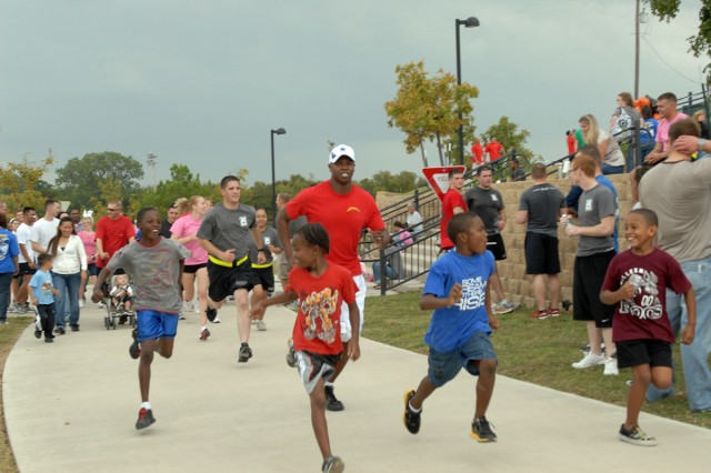 FORT HOOD, Texas-Soldiers and family members of the 3rd Assault Helicopter Battalion, 227th Aviation Regiment, 1st Air Cavalry Brigade, 1st Cavalry Division, take off on a one-mile family fun run, in Killeen, Texas, Oct. 23. The event was held in conjunction with a food drive to benefit the Cove House, a non-profit ministry that provides food and shelter to the homeless in Copperas Cove, Texas.