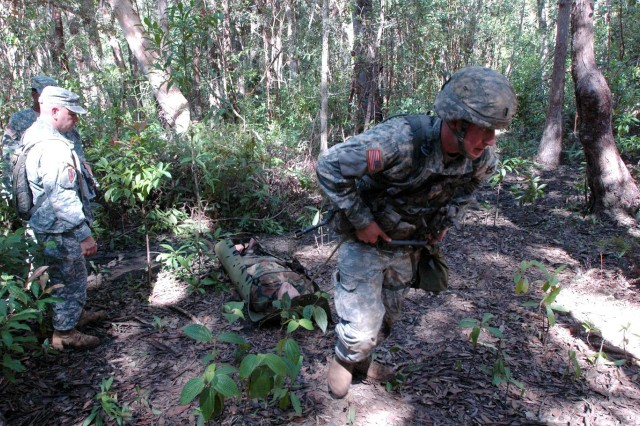 101021-A-2591M-100.jpg First Lieutenant Michael Sudweeks, UH-60 pilot and assistant team leader, C Company, 3rd Battalion, 25th General Support Aviation Battalion, 25th Combat Aviation Brigade, moves a casualty to safety for evacuation during the Expert Field Medical Badge (EFMB) Competition at the East Range field training facility, near Schofield Barracks, Oct. 21. Sudweeks earned the EFMB and was presented with the badge at an awards ceremony at Schofield Barracks' Sills Field, Oct. 22. (Photo by Sgt. 1st Class Tyrone C. Marshall Jr.  25th Combat Aviation Brigade Public Affairs)