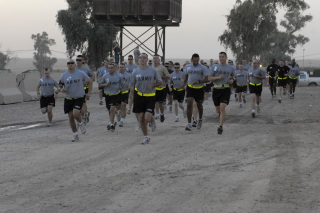 CONTINGENCY OPERATING SITE MAREZ, Iraq - Soldiers assigned to the 4th Advise and Assist Brigade, 1st Cavalry Division, Department of Defense employees  and civilians begin  running the Army Ten-Miler, here, Oct. 24.  Soldiers in the Long Knife brigade are currently deployed in support of Operation New Dawn but had the chance to participate in the annual Army tradition.
