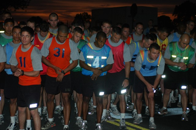 """FORT HOOD, Texas-Officers of the 41st Fires Brigade prepare to begin their two mile run during the brigades' officer APFT Challenge.  Competitors were graded individually as well as averaged as teams by battalion.  The """"Deep Strike"""" officers of 2nd Battalion, 20th Field Artillery Regiment took home the team title while Lt. Col. Steven Carpenter, executive officer of the 41st, won the individual gold."""