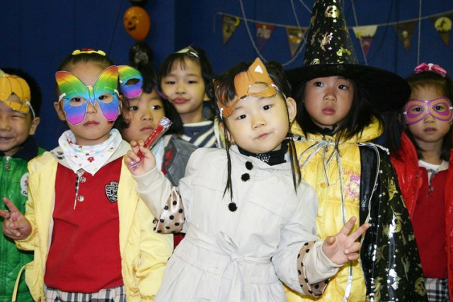 Dongurami Kindergarten students pose in their Halloween costumes during a party thrown by 17th Ordnance Company Soldiers.