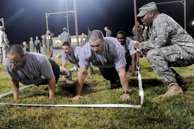 Sgt. David Melendez, front left, Sgt. Nicholas Chavez, back left, Staff Sgt. Brian Hayes, front right and Capt. Kelandis Evans, back right, all Company A, 795th Military Police Battalion and team 148, perform push ups as part of the Interservice Fitness Challenge on Gerlach Field, Oct. 22, at Fort Leonard Wood, Mo. This is the 4th year of the challenge.