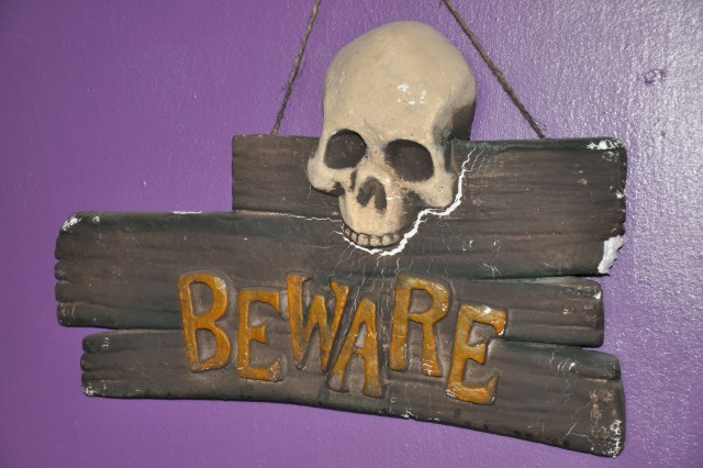 A sign at the Terror on Thomas Court haunted house warns visitors.