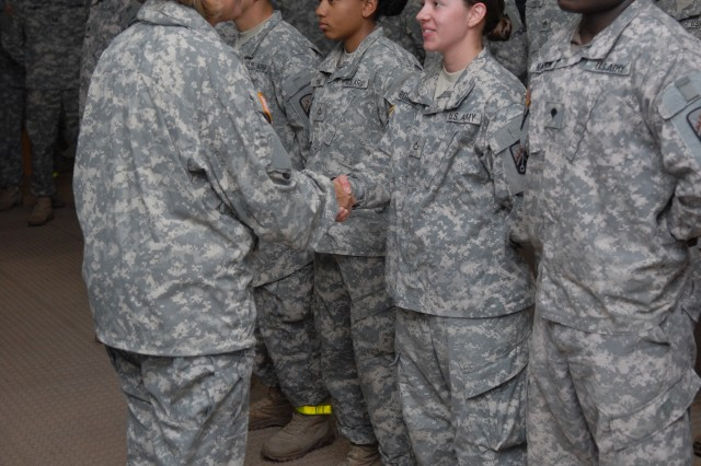 Private 1st Class Rachel Roberts, a native of Chico, Calif., and a signal support systems specialist with the 106th Finance Company, receives a commander's coin from Maj. Gen. Patricia E. McQuistion, the commanding general of the 21st Theater Sustainment Command, Oct. 25 during the  Saber Strike 2011 exercise at the Adazi Training Area in Latvia.