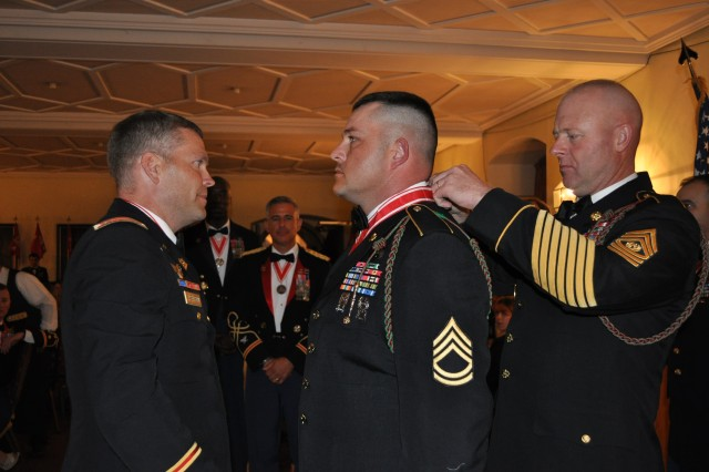 Sgt. 1st Class Raymond Barrick, an operations sergeant with Headquarters and Headquarters Company, 40th Engineer Battalion and a native of Carlisle, Pa., is awarded the Bronze de Fleury Medal Sept. 24 at the European Castle Ball in Wurzburg, Germany.