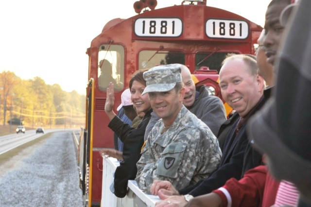 Anniston Army Depot Commander Col. Timothy Sullivan and Deputy to the Commander Jack Cline, along with other depot team members, greet LMP with excitement from the train tracks the morning of Oct. 21.