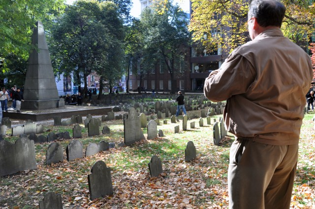 Scott Bullen pauses to snap a picture in the Granary Burying Ground on the Freedom Trail in Boston during USAG Natick's 2010 Organization Day.