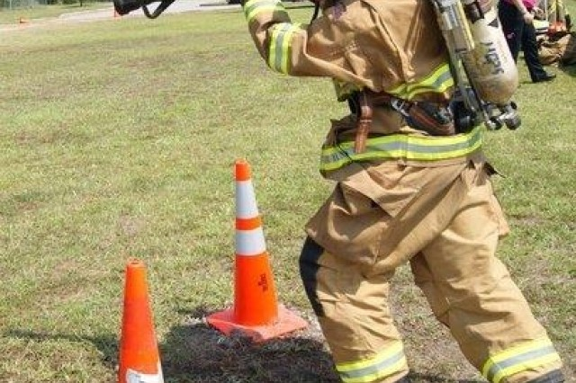 Lieutenant William Davis, a Hunter Army Airfield firefighter, drags a fire hose during the Liberty County Firefighting Challenge. He and Capt. Robert Gordon, also a Hunter firefighter, took second place in the competition with a combined time of 4 minutes, 40 seconds.