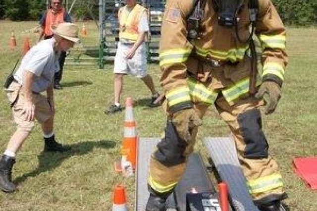 As part of the competition, firefighters were required to move an anvil-type object with a hammer three feet to assimilate the power required for a forcible entry in a burning building.