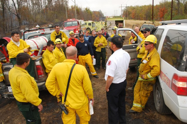 Fire Chief Marvin Gunderson brief the crews of firefighters that included the Fort Knox crew as well as many from the surrounding communities who sent aid in the form of trucks and manpower.