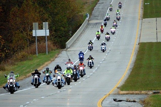 Participants in the 15th Military Police I/R Brigade Motorcycle Mentorship Program Autumn Ride, cruise down Missouri Highway 152 on their way to Kansas City, Mo., Oct. 22. The ride encompassed all types of riding - group, urban, country and staggered. Riders received free T-shirts, won motorcycle safety equipment and had free food, all provided by ride sponsors.
