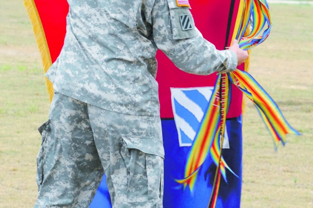 COL Pete Jones and CSM James Pearson uncase the 3rd HBCT colors Tuesday, signifying the unit's return from its fourth deployment.