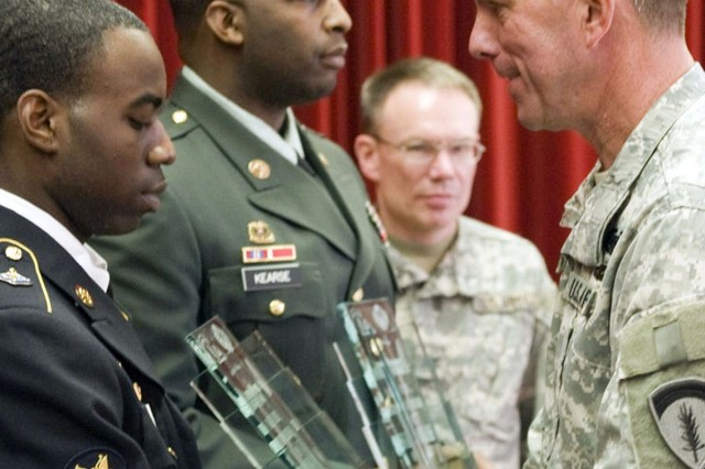 Spc. Danny Washington, 172nd Infantry Brigade, shakes hands with Brig. Gen. Paul Wentz, USAREUR's deputy chief of staff for logistics, as he is presented the U.S. Army Europe/Installation Management Command-Europe Culinary Warrior Soldier of the Year award at the 43rd annual food service fwards ceremony at Patrick Henry Village in Heidelberg, Germany, Oct. 28. The ceremony also recognized Staff Sgt. Keldric Kearse, also of the 172nd Infantry Brigade (second from left) as the Culinary Warrior NCO of the Year, and honored USAREUR and IMCOM-E's top dining facilities.